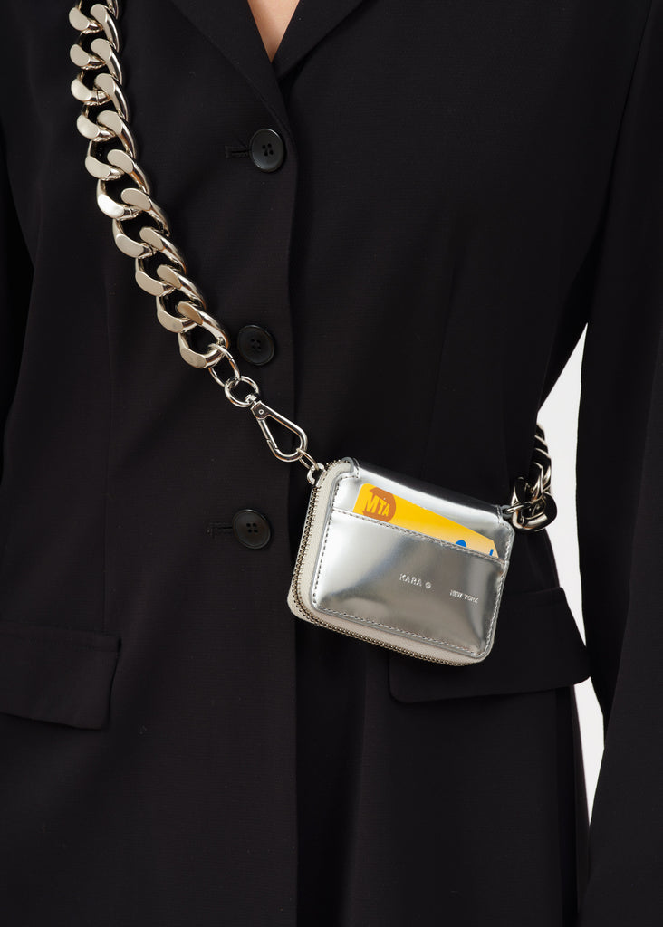Silver bike chain wallet worn to the side with metro card in front compartment