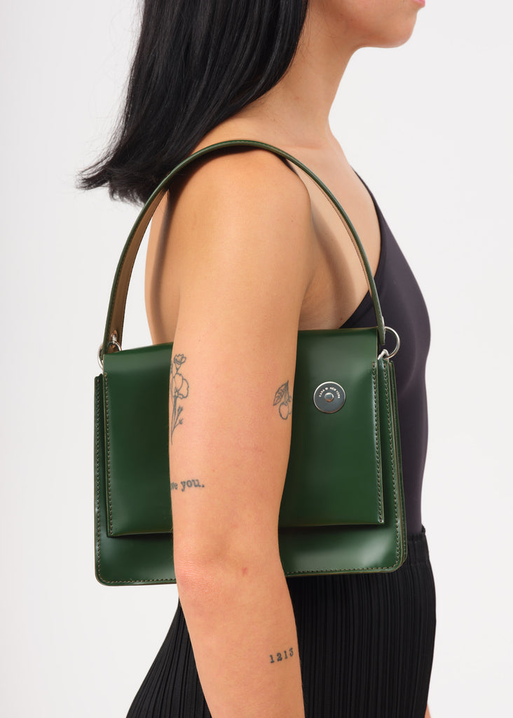 Model wearing green shoulder bag
