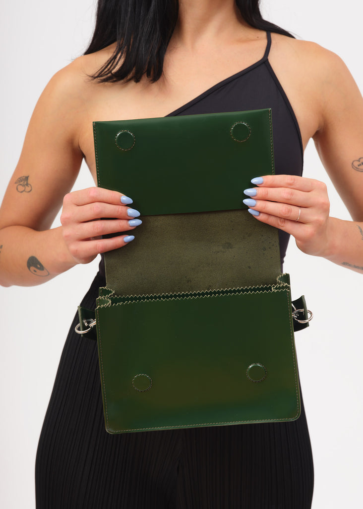 Model showing inside flap of green shoulder pinch bag