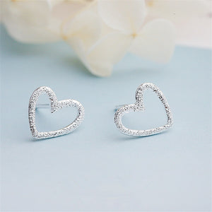 Tiny Hollow Heart Stud Earrings
