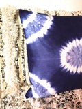 Tie dye blue and white cushion cover.