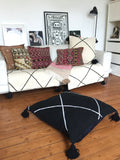 Large Beni Ouarain flat woven black floor cushion with Pom poms