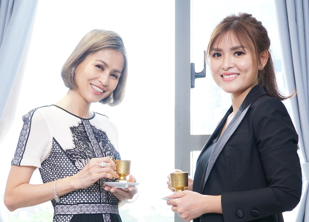 GLACYO's founders, Angelic Luong and Dr. Nhat Nguyen, smiling at the camera and holding a cup of tea.