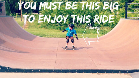 Child on skateboard ramp - you must be this big to enjoy this ride
