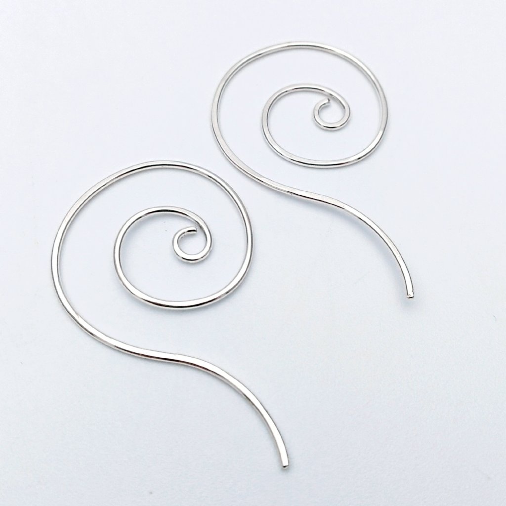Spiral earrings with tail