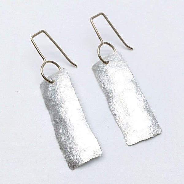 Silver short ships earrings
