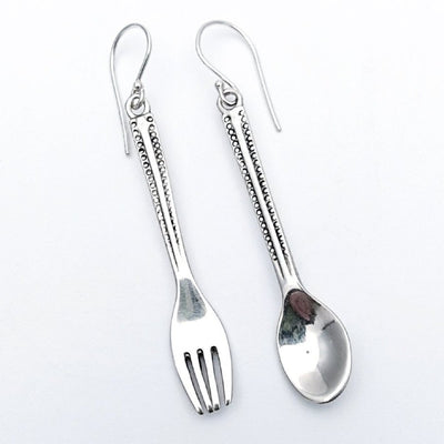 Silver head chef earrings