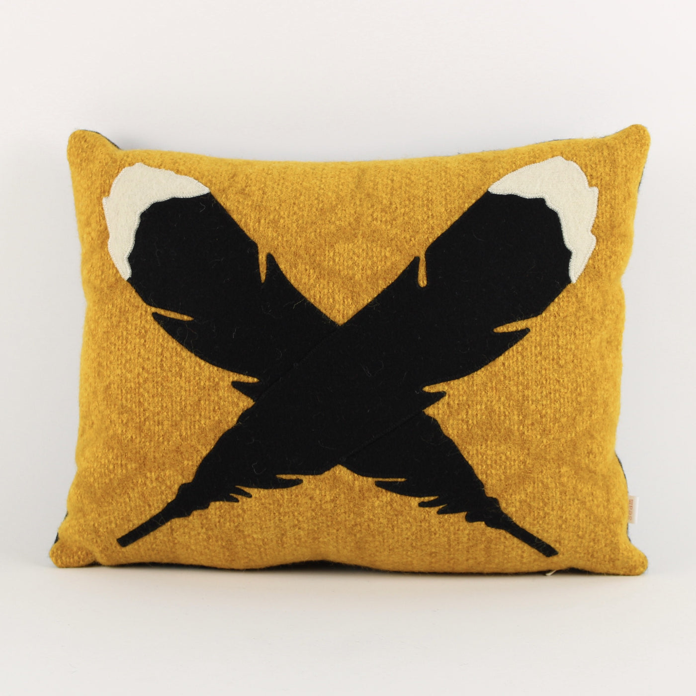 Huia feathers cushion- mustard background