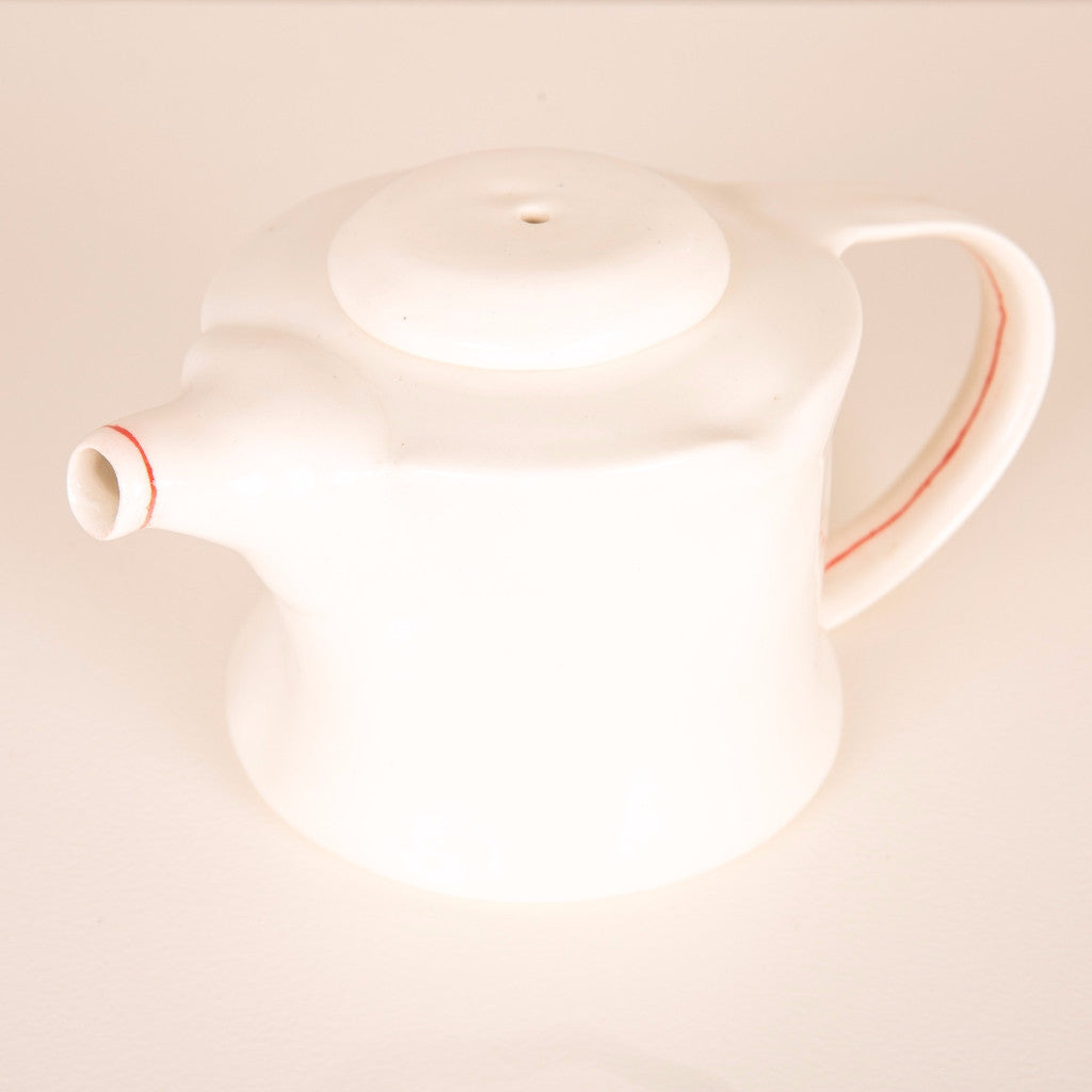 Teapot with red lines
