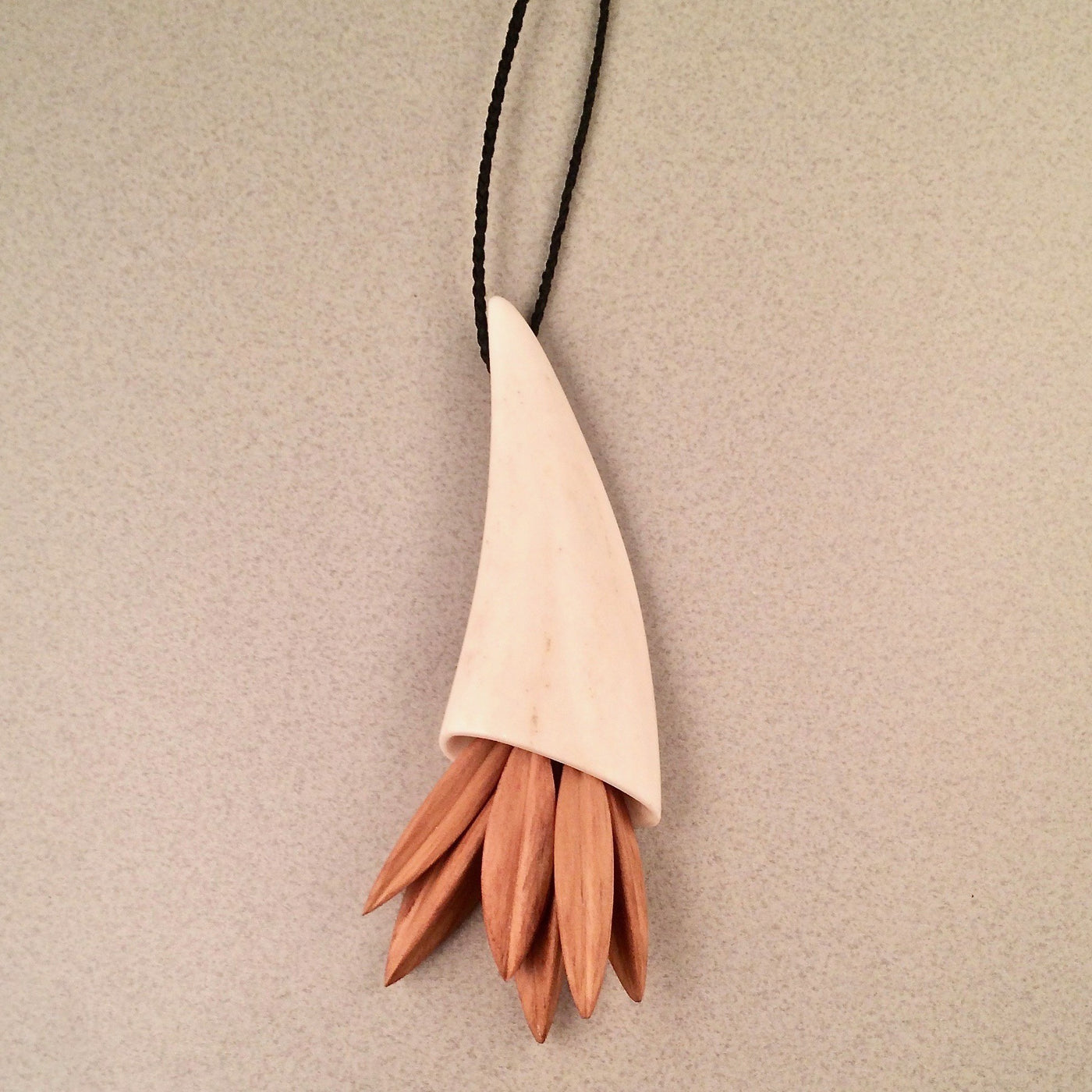 Antler cone and seedpod necklace (rimu, totora)
