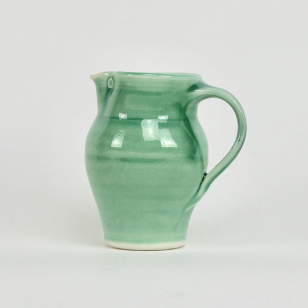 One pint jug - round green