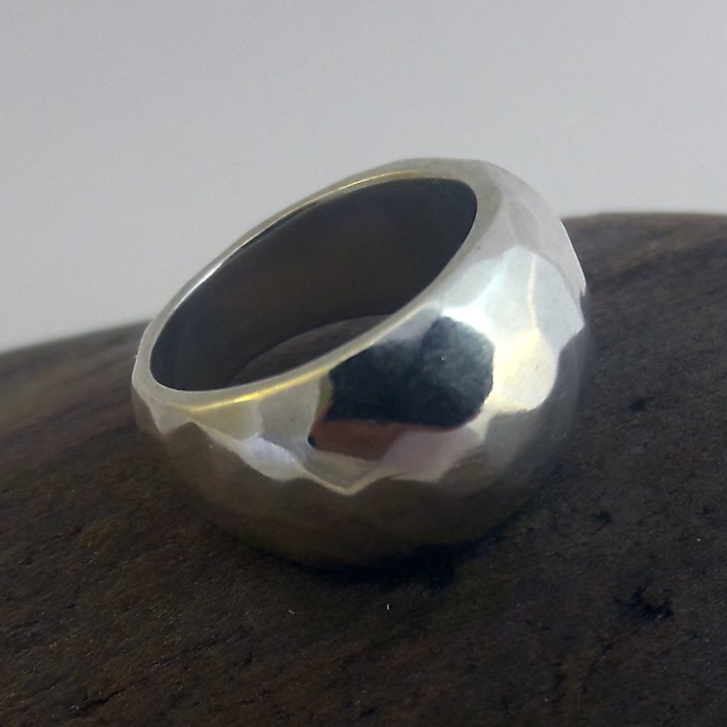 Silver faceteed domed ring