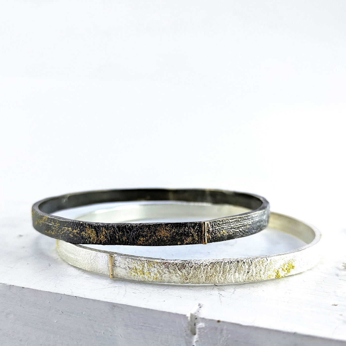 Glow Delve bangle - oxidised