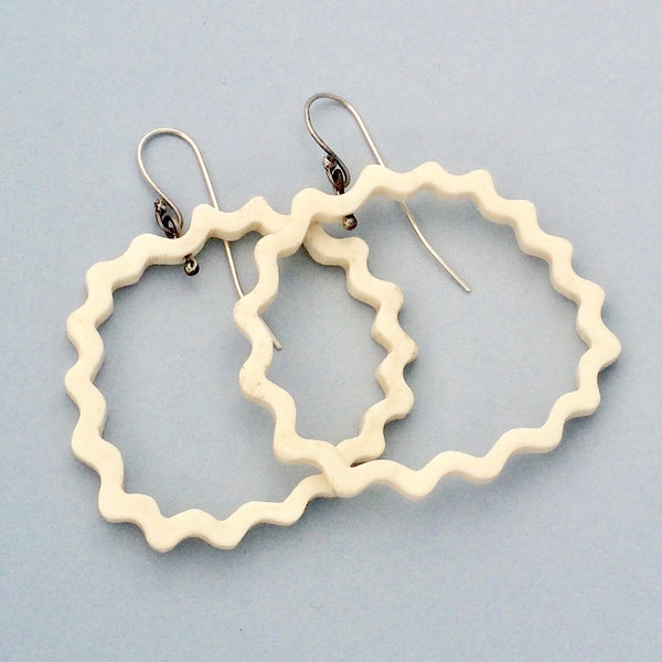 Large wavy circular bone earrings