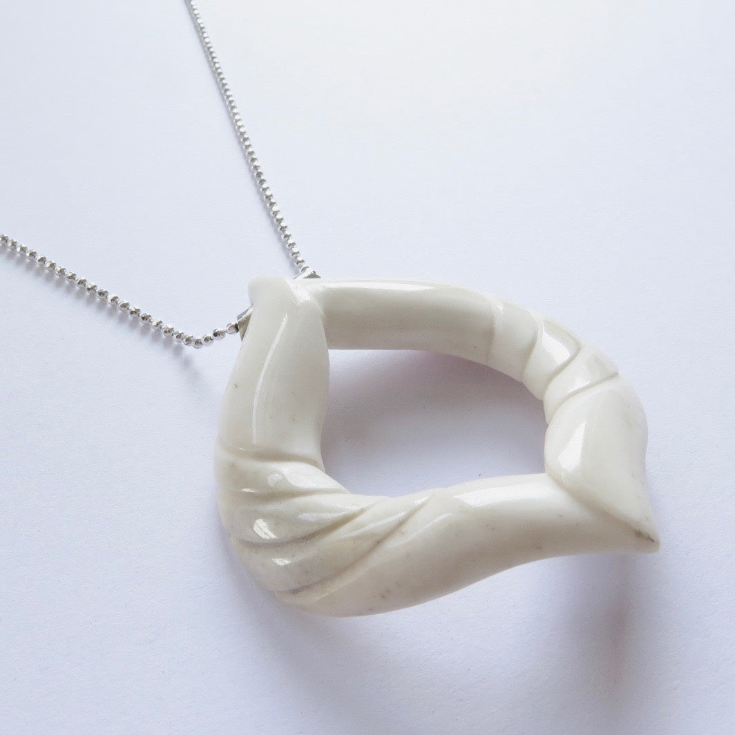 Angel wings bone pendant