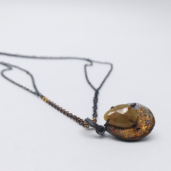 Future Artefact pendant with golden yellow sapphire