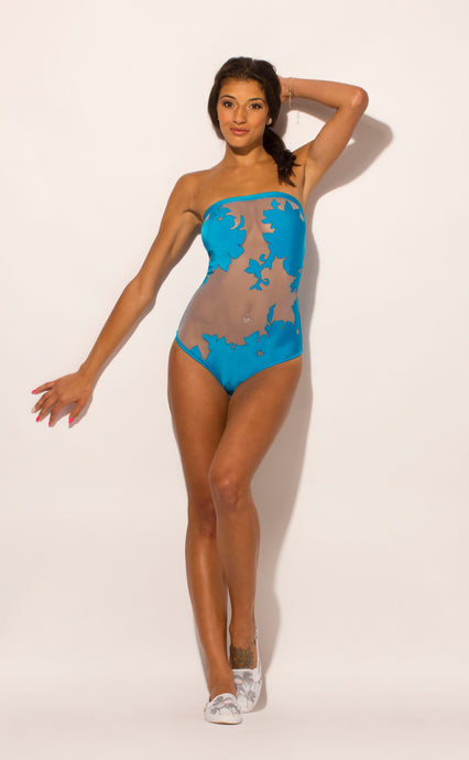 Sheer mesh strapless one piece swimsuit with floral embroidered appliques covering chest and crotch areas. Electric blue trim and panels