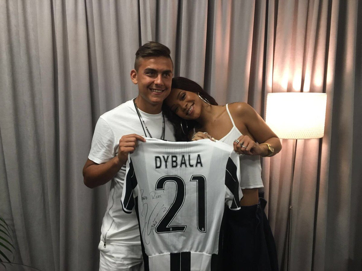 Dybala posing with Rihanna as they celebrate sharing the same birthday.