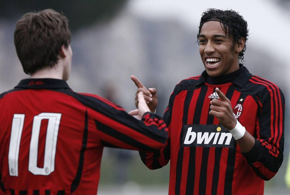 Aubameyang celebrates a goal with a teammate while playing for AC Milan