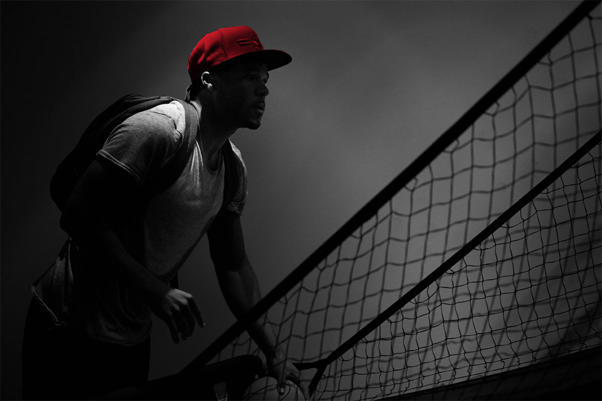 Ethan White wears the Delije cap: Passionate and burning flare red, this cap takes its name from the rambunctious supporters group of Red Star Belgrade.