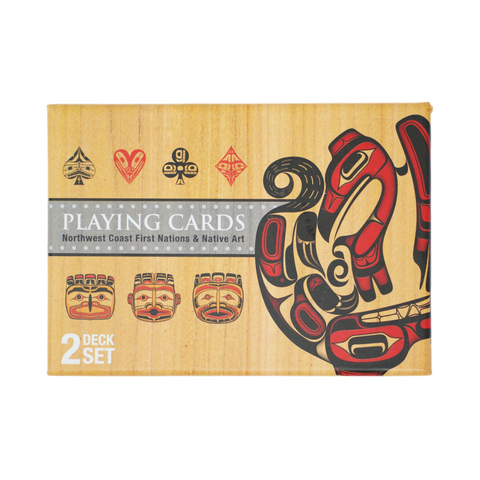 "Rectangular box with a wood-grain design for the background. The middle of the box has the words ""Playing Cards Northwest Coast First Nations & Native Art"" and the box is decorated with stylized depictions of the suits featured on cards"