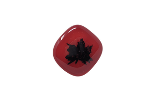 Red, diamond shaped glass pin with a black maple leaf
