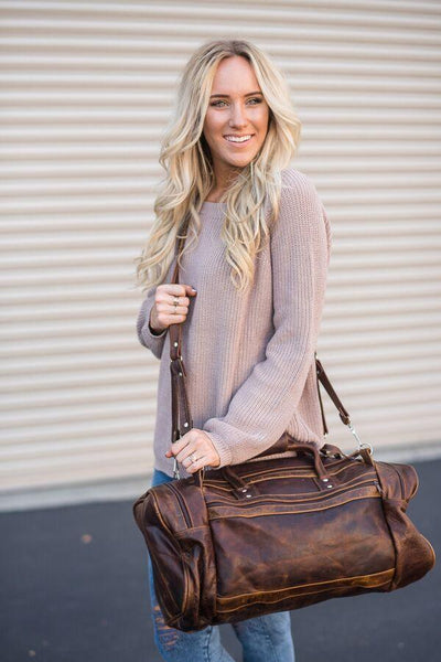 Travel broken in brown leather duffle bags