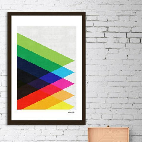 A framed poster with a black frame and colorful triangles.