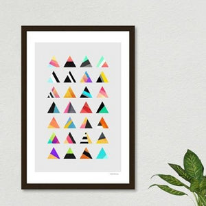 A framed poster with a montage of triangles printed on gray.