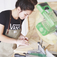 woman woodworker aprons