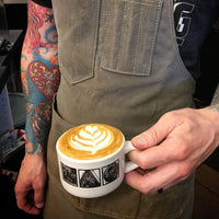 barista with wax canvas aritfact apron