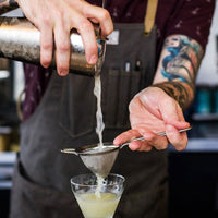 Artifact Bar Apron on mixologist