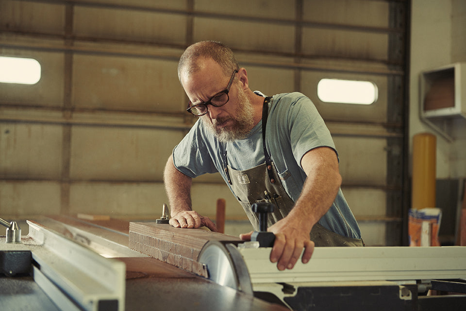 Todd McCollester in his Artifact Woodworking Apron Using an Altendorf Sliding Panel Saw