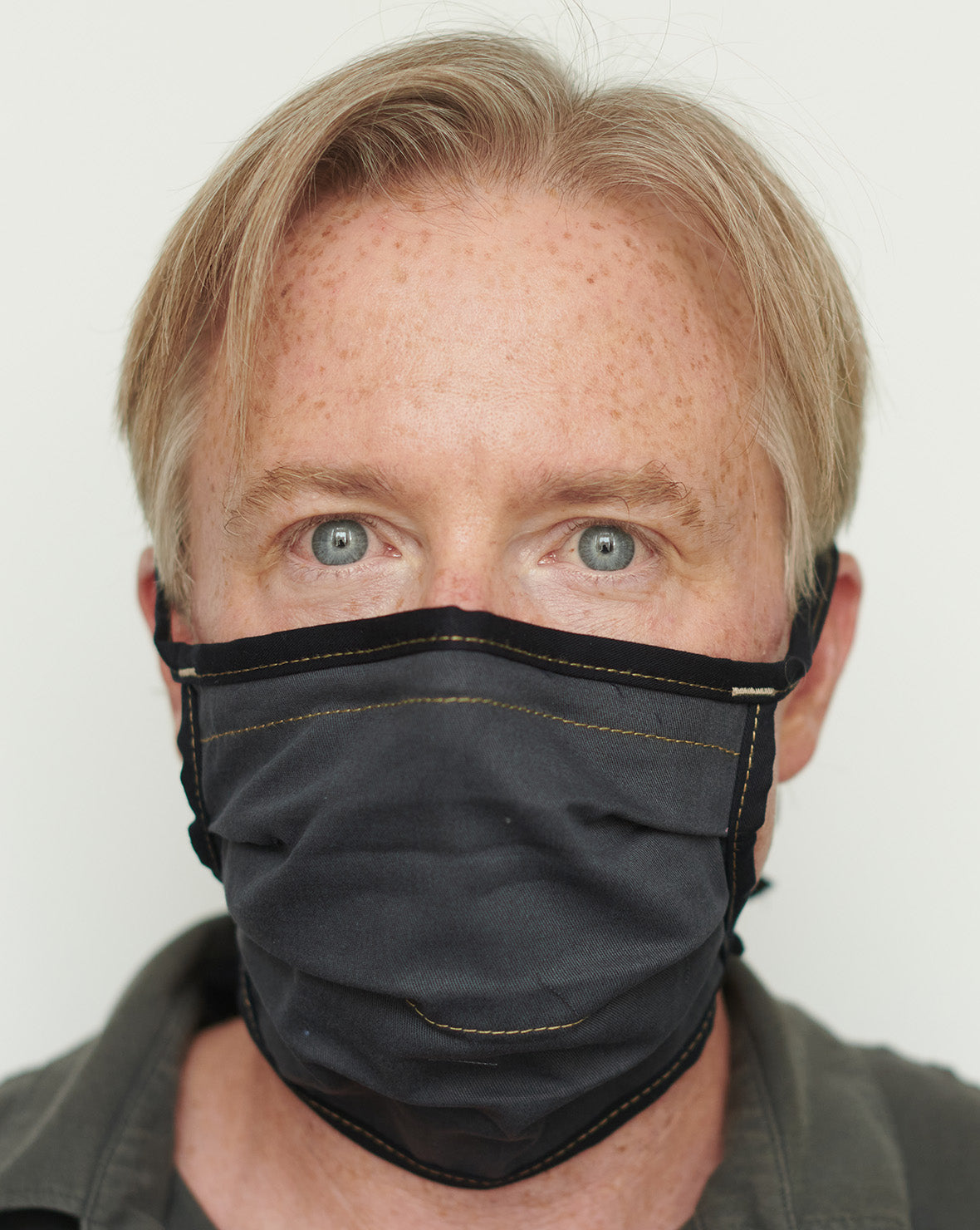 Jeremy wearing a slate / navy mask