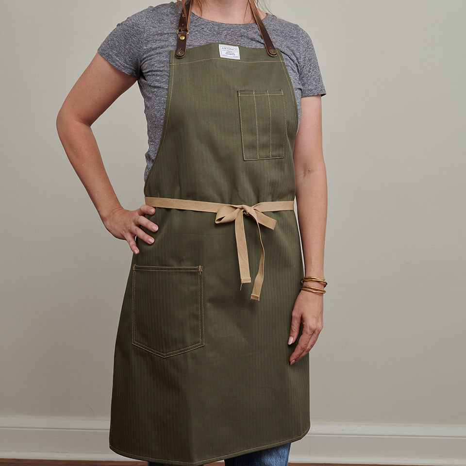 olive herringbone twill apron - woman model