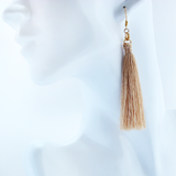 gold glow tassel earrings