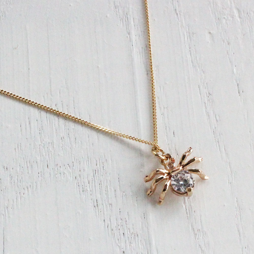golden crystal spider necklace