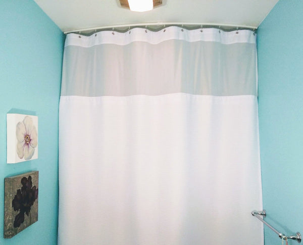 shower curtain track with oversize curtain