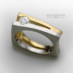 This structured, architectural design features a 5.3mm round-cut stone. Pictured here: 0.33 ct diamond set in 18K two-tone gold. Design is fully customizable via stone type, quality, gold color and gold karat.