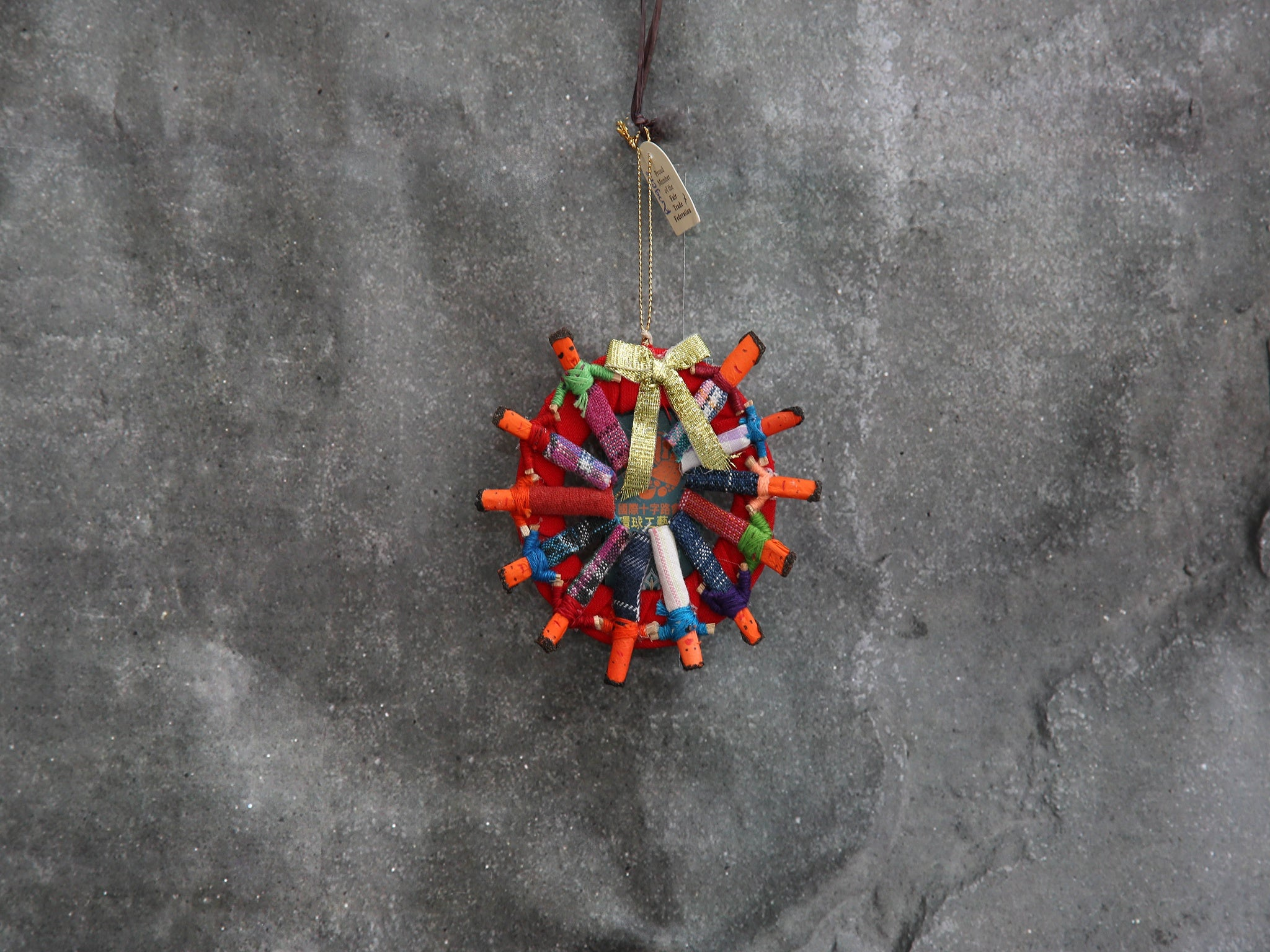 small wreath ornament w/ worry dolls