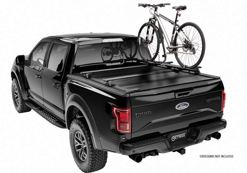 Powertrax Pro XR Bed cover shown closed with rack accessory added on a black Raptor