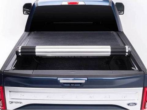 BAK Revolver X2 Bed Cover for 2015-2019 F-150's shown in a blue Platinum F-150 half rolled