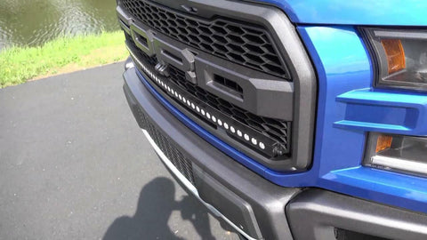 Roush F-150 Grille letters in white on a white Roush F-150 by specialty performance vehicles llc