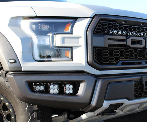 2017-2019 Baja POD fog lights shown in a White Raptor controlled by auxiliary switches in the Raptor