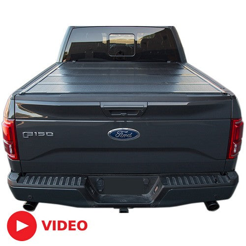 BAKFlip FiberMax Bed Cover 2015-2019 F-150 on a Red F-150 sideview with one panel flipped back