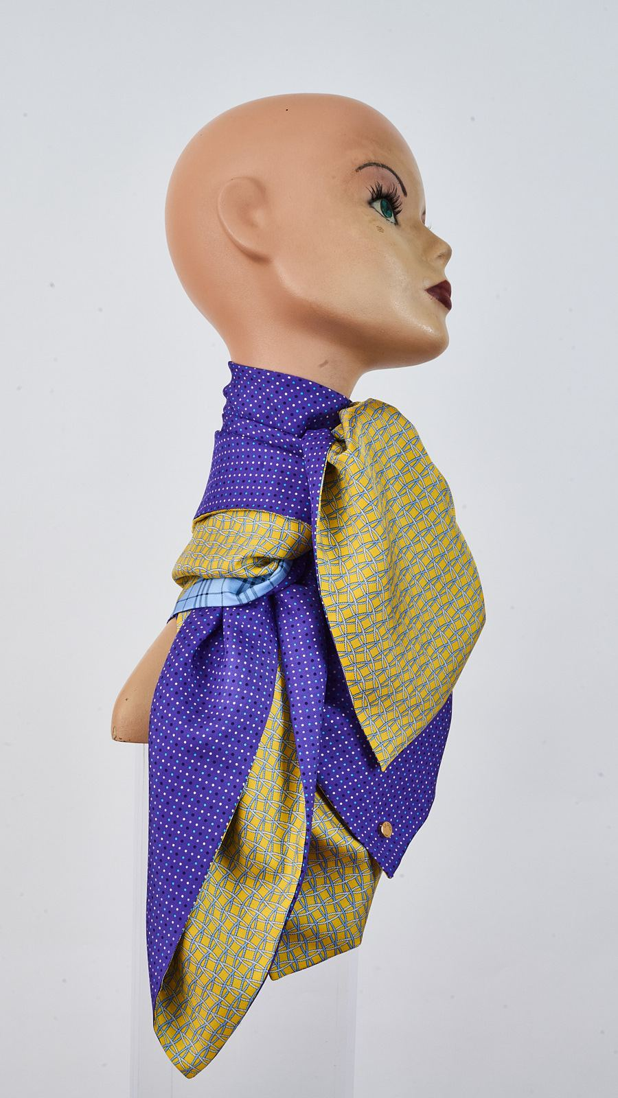 Printed yellow and purple silk carre tied around neck