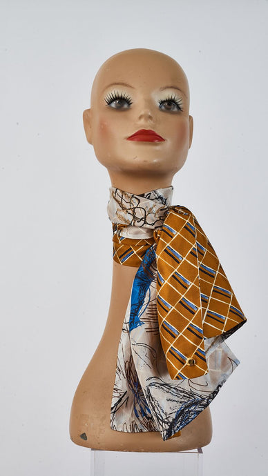 Double sided Printed caramel and sketch silk  scarf tied around neck