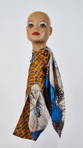 Printed caramel and sketch large silk scarf tied around neck