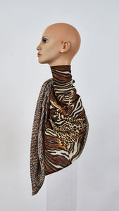 Printed safari and reptile large silk scarf tied around neck side view