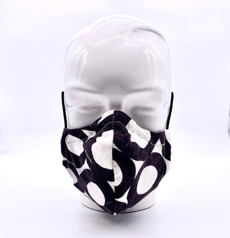 Very dark brown and white mask